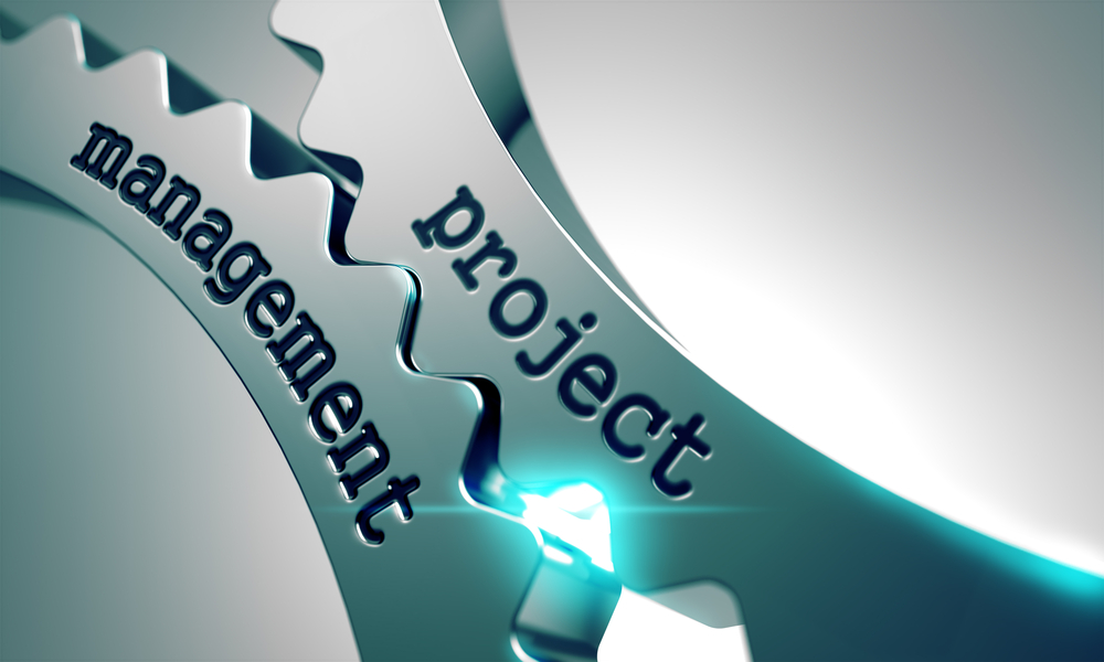Turning gears illustrate how project management can help in construction